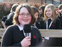 A School Reporter holding a mic