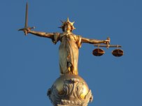 A statue of Lady Justice, which stands on top of the the Central Criminal Court, London