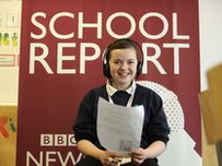 School Reporter wearing headphones and reading a script