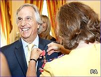 Henry Winkler receiving his OBE