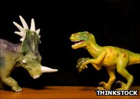Toy dinosaurs fighting