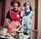 Mother and daughter baking (Getty Images)