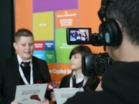 School Reporters presenting in front of the camera
