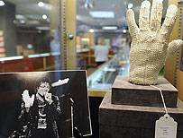 A white rhinestone spandex glove used in the late 1970s by pop star Michael Jackson on display at a preview of Bonhams & Butterfields Legends and Goddesses entertainment memorabilia auction, June 2010 in Los Angeles (AFP)