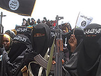 Women from al-Shabab carrying weapons in Mogadishu (AFP)