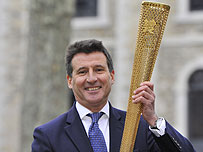 Lord Coe with an Olympic torch