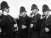 Police officers from Kent Constabulary using portable radios in 1963