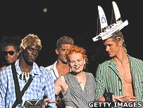 Vivienne Westwood with male models in her designs