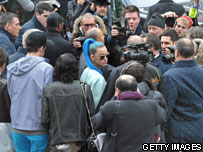 Katy Perry surrounded by paparazzi