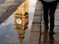Reflection of Big Ben in a puddle