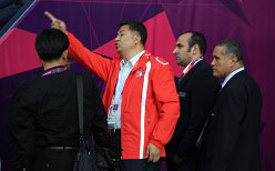 A North Korean official points at the wrong flag