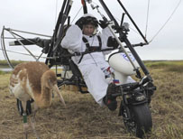 Vladimir Putin in a motorised hang-glider with a crane