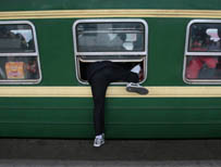 Man in Nanjing boards a train through the window