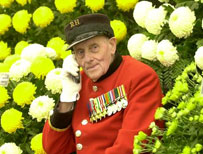 Chelsea pensioner with flowers