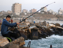 Fishing on the shore in Gaza
