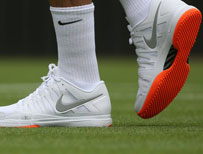 Federer's orange soles
