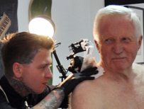 David Dimbleby being tattooed
