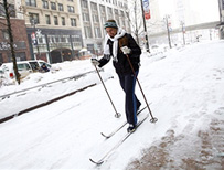 Woman skiing to work in Detroit