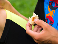 Athlete eating bread
