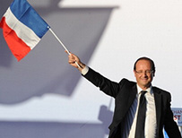 Francois Hollande waving French flag