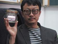 Artist holding jar