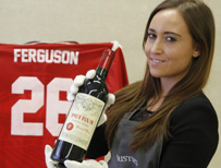 Staff at Christies holding Ferguson's wine