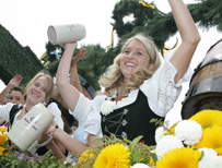 Waitresses in Munich raise their beer glasses
