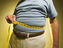 Large person measuring waist