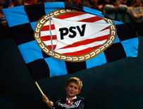 A PSV supporter holding a flag