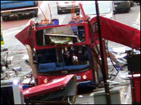 Double-decker bus with its roof blown off
