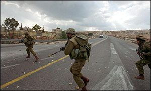 Israeli soldiers run for cover