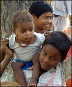 Indian children caring for a baby
