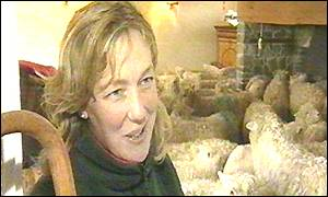 Liz Dawson with her flock of sheep in her home