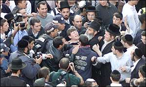 Police try and calm orthodox Jews after the blast