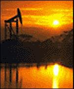 A nodding donkey oil well at sunset
