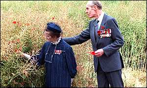 Baroness Ryder and Group Captain Cheshire picking poppies