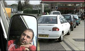 Drivers wait at an Esso station in London