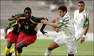 Abdelaziz Benhamlat of Algeria and Marc Vivien Foe