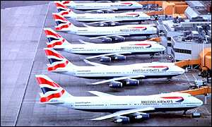BA planes lined up at an airport