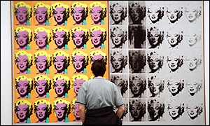 Visitor inspects Andy Warhol piece