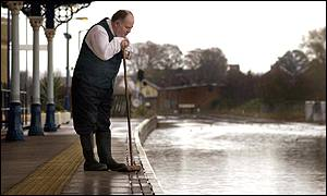 station supervisor looks at flooded line