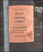 Flood meeting sign