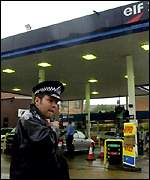 policeman at petrol station