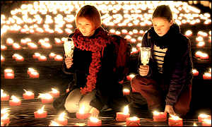 Girls in Dresden light candles to mark Kristallnacht (Night of Broken Glass)