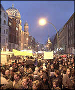 Thousands of people gather in front of a Jewish synagogue in Berlin during a protest action against right-wing extremism