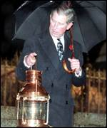 Prince Charles receiving flame