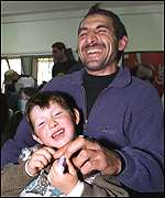 Passengers Avsalutin Rashidov and his son Arsen after being released