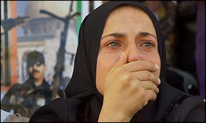 A Palestinian woman weeps during a funeral in Bethlehem