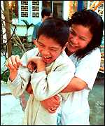Dr. Nguyen Thi My Hien with an Agent Orange victim