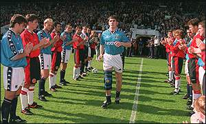 Paul Lake is welcomed to the pitch by both teams for his testimonial